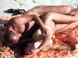 Voyeur on overturn beach. Sex with girl with silicone Boobs