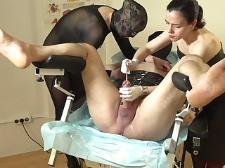 Kinky mistress Patricia MedicalySado gives a tugjob to filial seated in gynecological chair