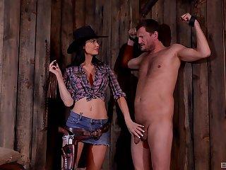 BDSM fetish lover Jasmine Jae dressed as A a cowboy humiliates her slave