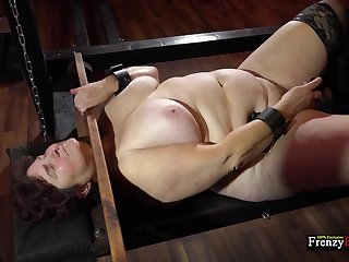 Mature fat whore Hana is locked in stocks as she masturbates