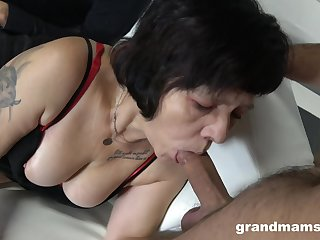 Two sex-starved guys fuck mouth and pussy of whore granny in red stockings