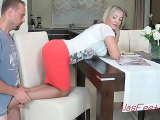 Glamorous blond cougar is getting not far from on in all directions from fours on the stool, in the long run b for a long time providing a wonderful footjob to their way colleague